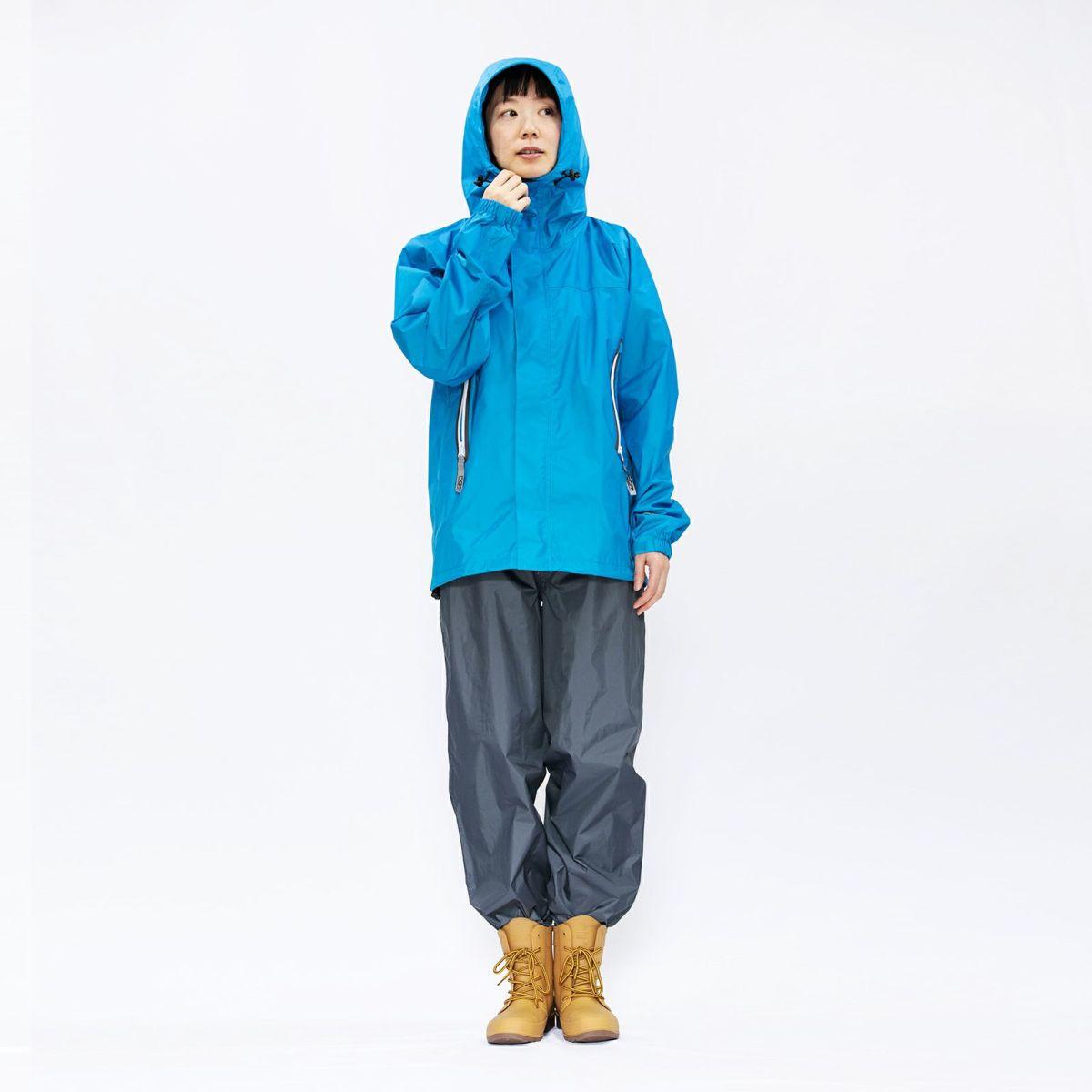 [女性モデルのサイズ]身長:168cm 着用サイズ:M ※写真は7720 KJ レインパンツとなります。当商品「7730 EX」は、さらにフロントにはボタンとファスナー、裾にはファスナーがつき調整可能です。